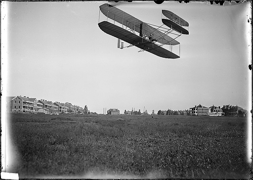 http://www.archives.gov/press/press-kits/picturing-the-century-photos/orville-wright-in-aeroplane.jpg