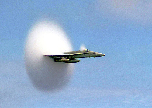 http://commons.wikimedia.org/wiki/File:FA-18_Hornet_breaking_sound_barrier_(7_July_1999).jpg