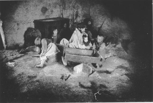http://commons.wikimedia.org/wiki/Image:Starving_Irish_family_during_the_potato_famine.JPG