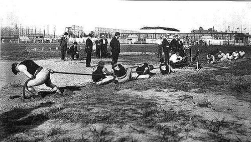 http://commons.wikimedia.org/wiki/File:1904_tug_of_war.jpg