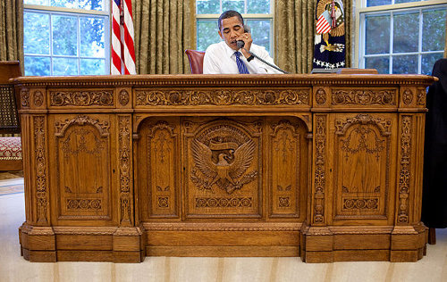 http://commons.wikimedia.org/wiki/File:Barack_Obama_sitting_at_the_Resolute_desk_2009.jpg
