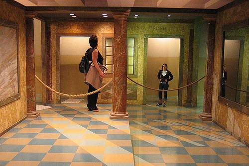 http://commons.wikimedia.org/wiki/File:Ames_room_forced_perspective.jpg