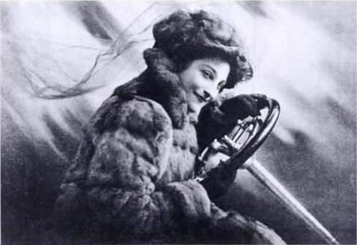 http://en.wikipedia.org/wiki/File:Dorothy_Levitt_Frontspiece_to_The_Woman_and_the_Car.jpg