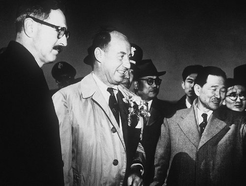 http://commons.wikimedia.org/wiki/File:Stevenson_and_Korean_officials_at_USAF_base_in_Korea,_March_1953.jpg