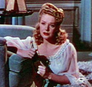 http://commons.wikimedia.org/wiki/File:Alice_Faye_in_The_Gang's_All_Here_trailer_cropped.jpg