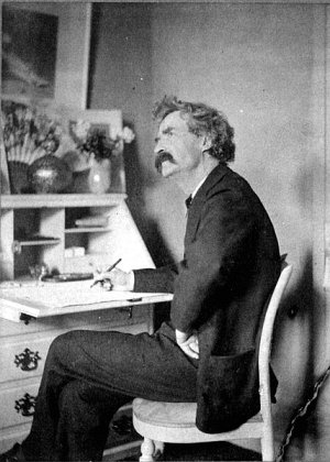 http://commons.wikimedia.org/wiki/File:Mark_Twain_pondering_at_desk.jpg