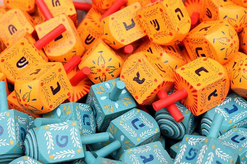 http://commons.wikimedia.org/wiki/File:Colorful_dreidels2.JPG