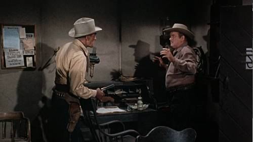 http://commons.wikimedia.org/wiki/File:Randolph_Scott_and_Barry_Kelley_in_Buchanan_Rides_Alone.png