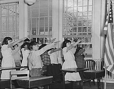 http://commons.wikimedia.org/wiki/File:Students_pledging_allegiance_to_the_American_flag_with_the_Bellamy_salute.jpg