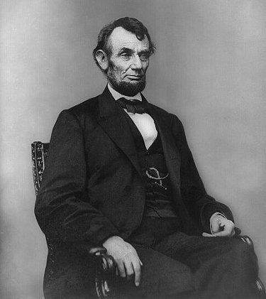 http://commons.wikimedia.org/wiki/File:Abraham_Lincoln_seated,_Feb_9,_1864.jpg