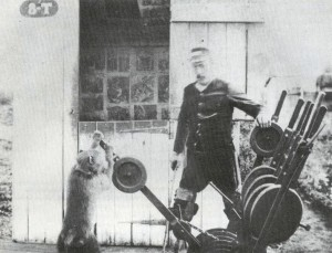 http://commons.wikimedia.org/wiki/File:Disabled_Signalman_with_his_trained_Baboon_assistant_-_Uitenhage_railway_-_Cape_Colony_1884.jpg