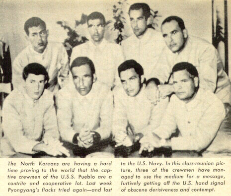 https://en.wikipedia.org/wiki/File:North_Korea_Propaganda_Photograph_of_prisoners_of_the_USS_Pueblo,_with_the_Hawaiian_Good_Luck_Sign,_1968.jpg