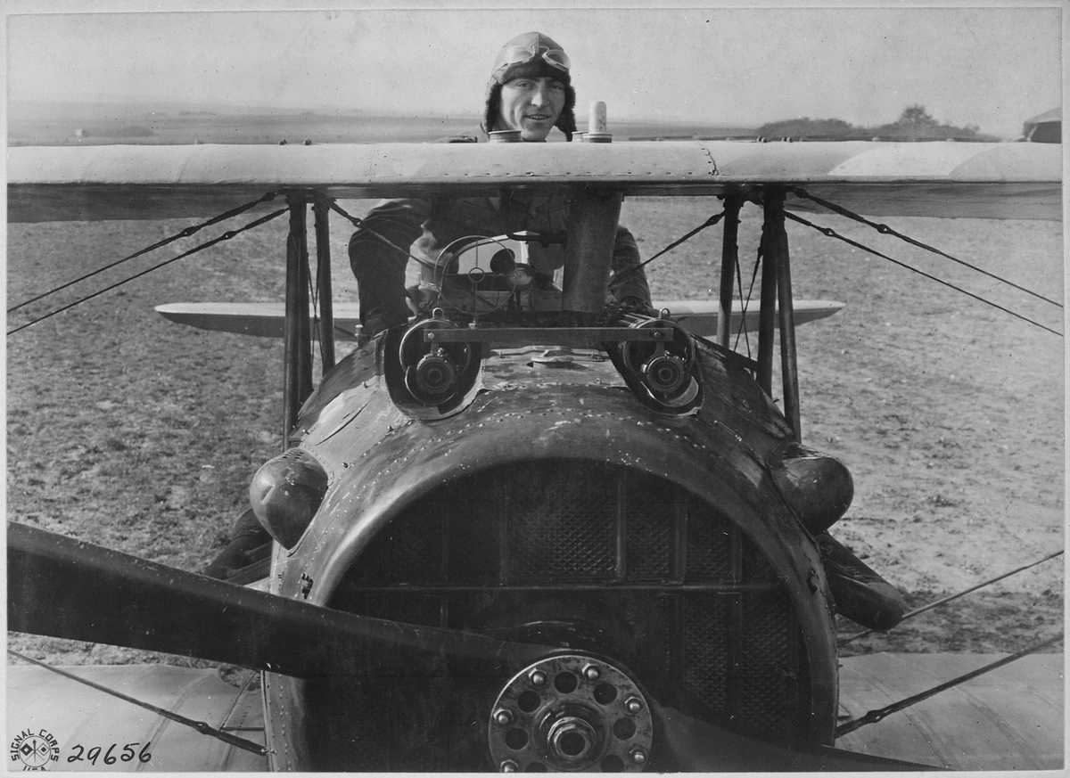 https://commons.wikimedia.org/wiki/File:First_Lieutenant_E._V._(Eddie)_Rickenbacker,_94th_Aero_Squadron,_American_ace,_standing_up_in_his_Spad_plane._Near..._-_NARA_-_530773.tif