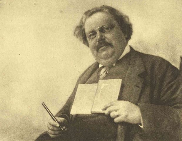 https://commons.wikimedia.org/wiki/File:Chesterton_Holding_Book_and_Pen.jpg