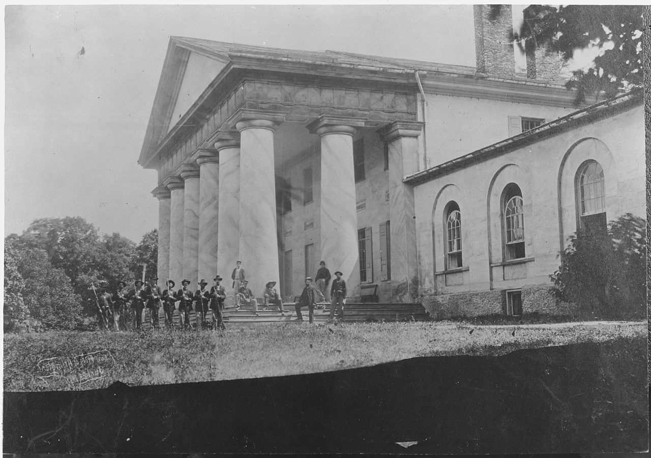 https://commons.wikimedia.org/wiki/File:East_front_of_Arlington_Mansion_(General_Lee%27s_home),_with_Union_soldiers_on_the_lawn,_06-28-1864_-_NARA_-_533118.jpg