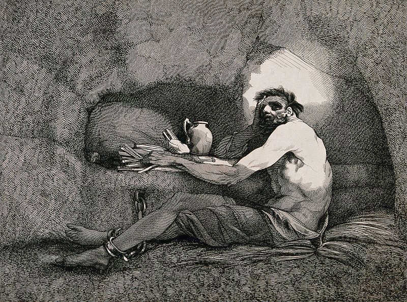 https://commons.wikimedia.org/wiki/File:A_prisoner_is_sitting_on_straw_in_a_cave_with_his_feet_chain_Wellcome_V0041238.jpg